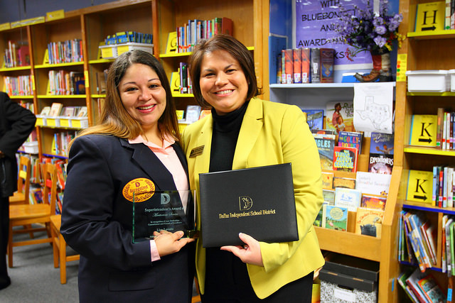 Dan D. Rogers Principal Lisa Lovato (left) received the Superintendent's Award for her leadership of the East Dallas elementary school