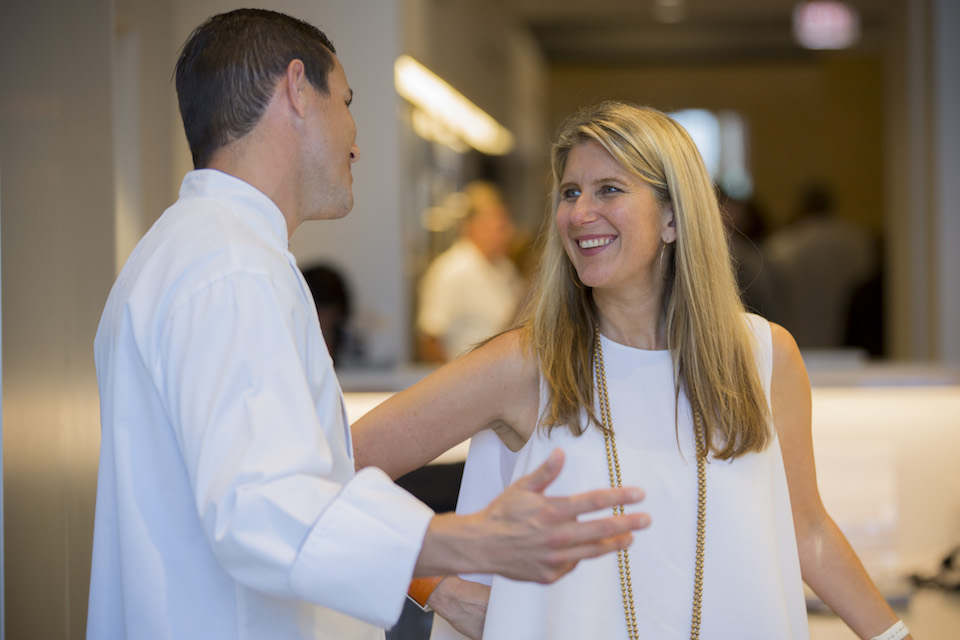 Luxury Portfolio International® Executive Vice President Stephanie Pfeffer Anton speaks with a forum attendee.