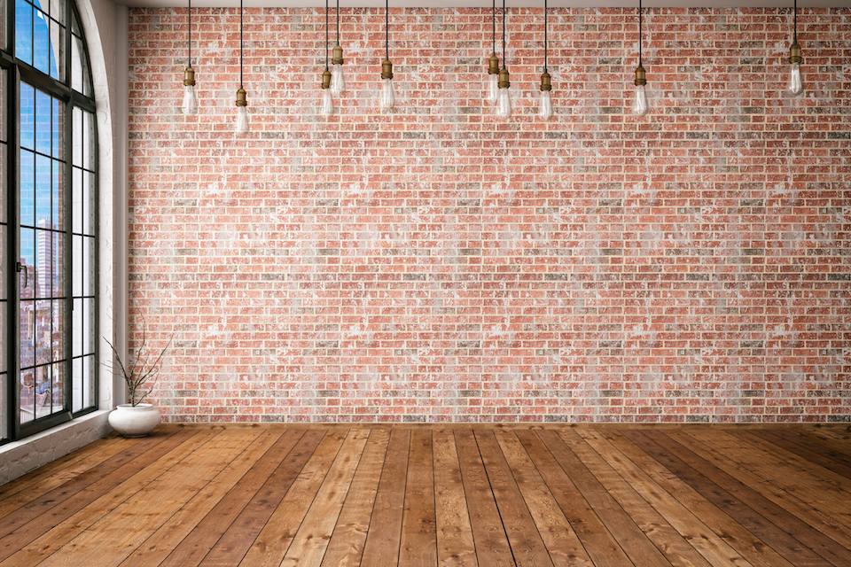 Empty brick wall with edison lights