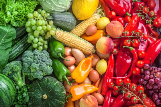 Fruits and vegetables overhead assortment colorful background green, yellow to red