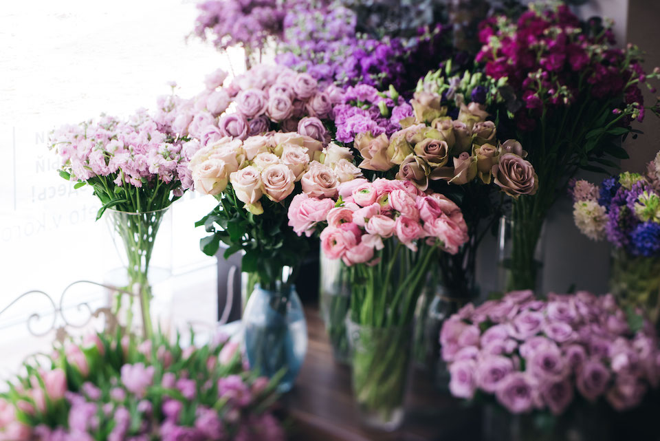 Fresh blossoming flowers at at the florist shop (roses, ranunculus, tulips, carnations, mattiola,)