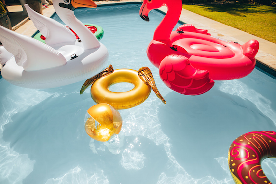 Colorful inflatable toys floating in a pool