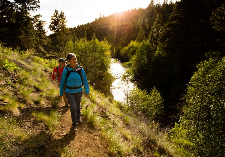Hikers at sunset at Whychus Canyon Preserve. Michelle Bergeron and Pat Gaunt.