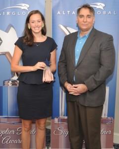 Rebecca Adams accepting award on behalf of Helen Adams Realty