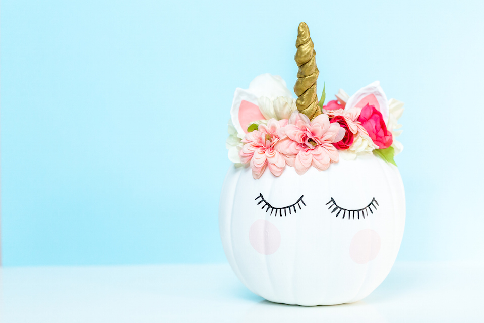 Craft pumpkin painted white and decorated with pink flowers